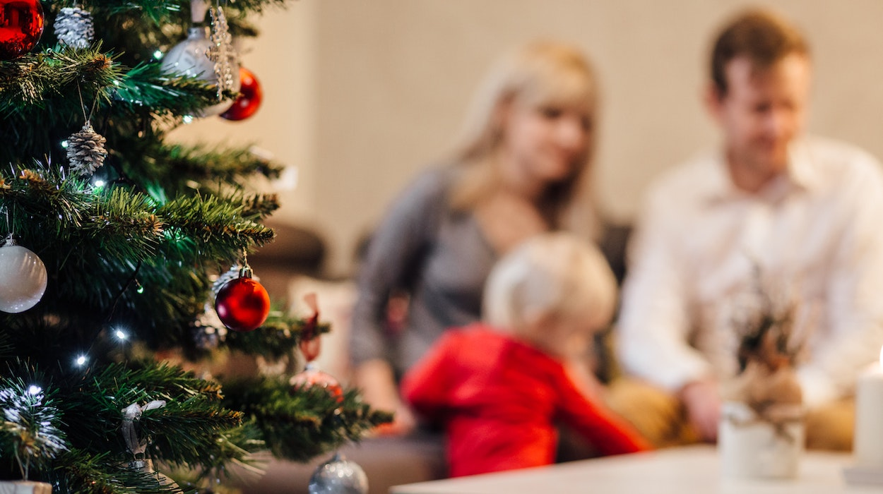 people-on-christmas-tree-at-home-during-winter-257910.jpg
